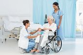 picture of paramedic  - doctors and patient in wheelchair at the hospital - JPG