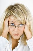 stock photo of frazzled  - disheveled distraught young blonde girl with glasses - JPG