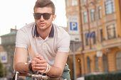 image of biker  - Portrait of stylish biker on street background - JPG