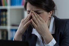 foto of sinuses  - Business worker at office with sinus pain - JPG
