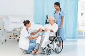 pic of wheelchair  - doctors and patient in wheelchair at the hospital - JPG