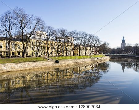 TURKU, FINLAND - APRIL 30: Buildings and leafless trees by the River Aurajoki in Turku at April 30, 2016