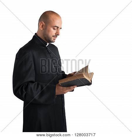Man priest reads the bible sacred text