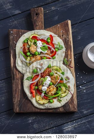 Chicken meatballs and fresh vegetables tacos. Healthy delicious breakfast or snack. On wooden rustic board