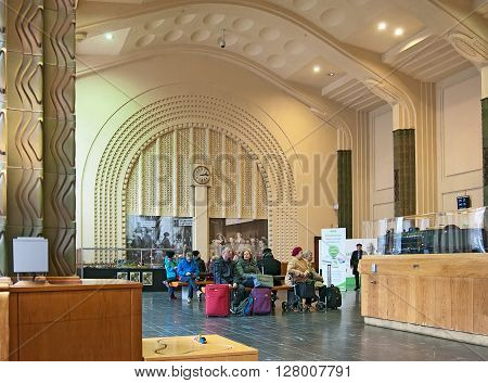 HELSINKI, FINLAND - APRIL 23, 2016: People in the ticket hall at The Central Railway Station. The Railway Station Building was designed by Eliel Saarinen in Art Nouveau Style and opened in 1919.