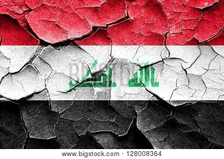 Grunge Iraq flag with some cracks and vintage look