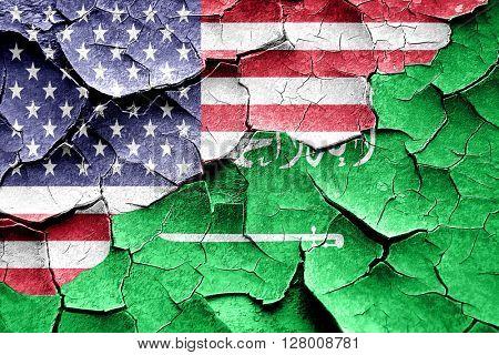 Grunge Saudi Arabia flag with american flag combination
