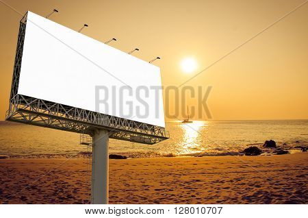Blank Billboard Ready For New Advertisement On The Beach With Sunset