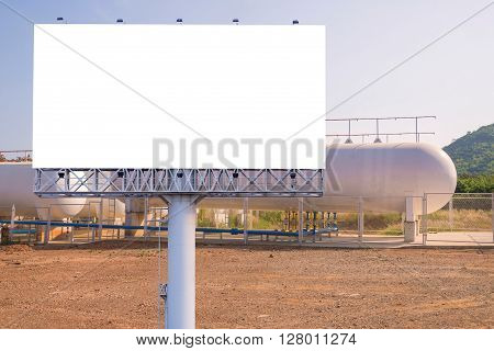Blank Billboard For Advertisement With Natural Gas Storage Tanks In Industrial Plant