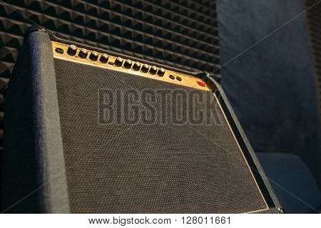 Electric guitar amplifier closep with free spce. Black professional guitar amplifier