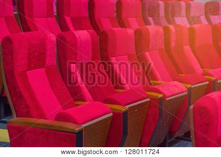 empty chairs in theatre or conference hall. ** Note: Shallow depth of field