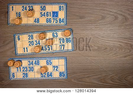 Vintage lotto: kegs and cards. Placed on a wooden countertop.