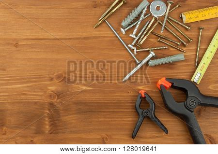 Set of tools and instruments on wooden background. Different kinds of tools for household chores. Home repairs. Father's Day.