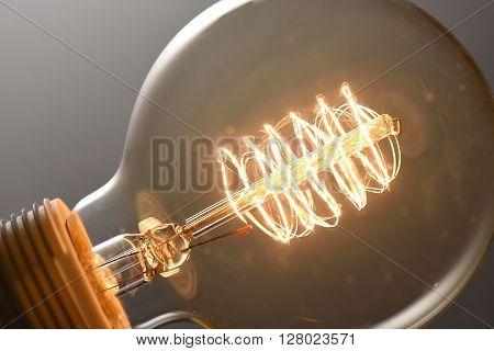 Close up photo glowing vintage light bulb