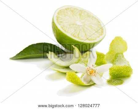 Blossom zest leaf and half of lime fruit isolated on white background.