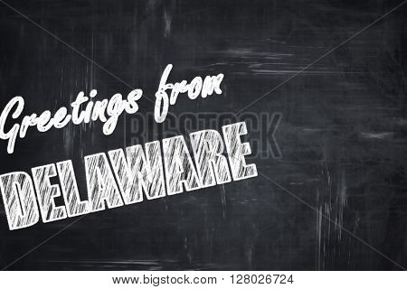 Chalkboard background with chalk letters: Greetings from delawar
