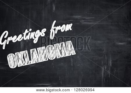 Chalkboard background with chalk letters: Greetings from oklahom