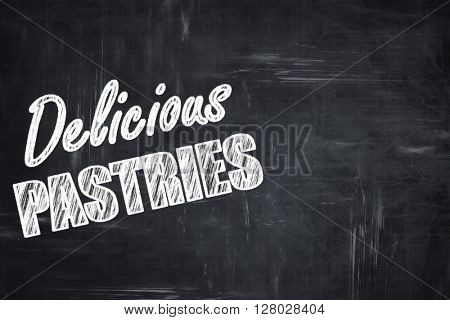 Chalkboard background with chalk letters: Delicious pastries sig