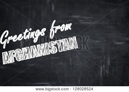 Chalkboard background with chalk letters: Greetings from afghani