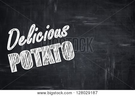 Chalkboard background with chalk letters: Delicious potato sign