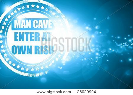 Blue stamp on a glittering background: man cave sign