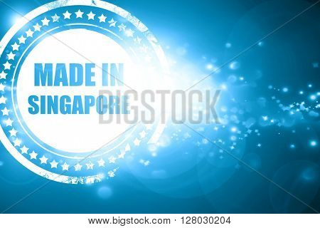 Blue stamp on a glittering background: Made in singapore