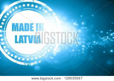 Blue stamp on a glittering background: Made in latvia