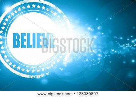 Blue stamp on a glittering background: believe