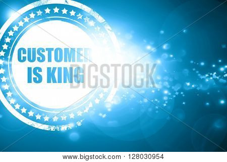 Blue stamp on a glittering background: customer is king