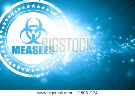 Blue stamp on a glittering background: Measles concept backgroun
