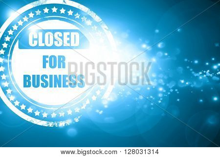 Blue stamp on a glittering background: Closed for business