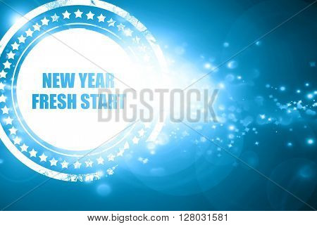 Blue stamp on a glittering background: new year fresh start