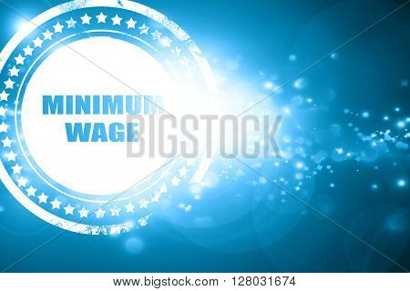 Blue stamp on a glittering background: minimum wage