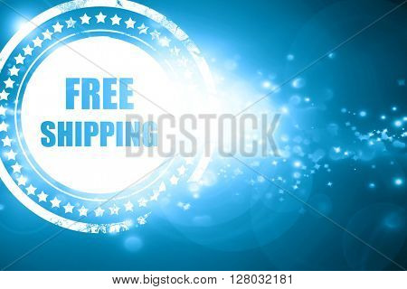 Blue stamp on a glittering background: free shipping sign