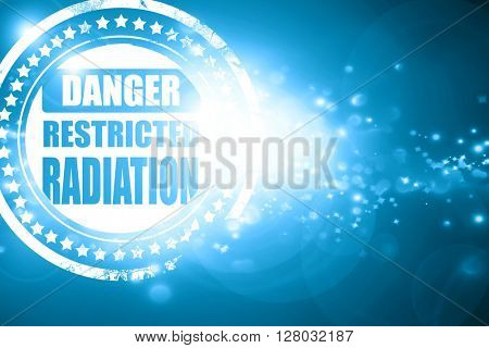 Blue stamp on a glittering background: Nuclear danger background