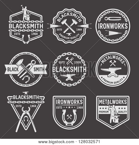 Blacksmith white emblems on black background with working master anvil hammer chain pincers horseshoe isolated vector illustration