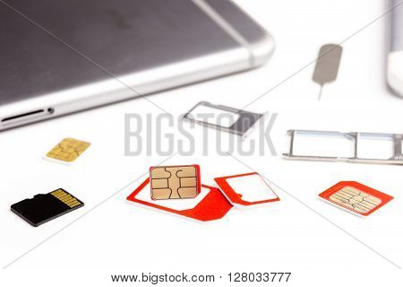 many sim card sim card adapter sim card eject tool and digital media micro sd card and smart phone put on white background