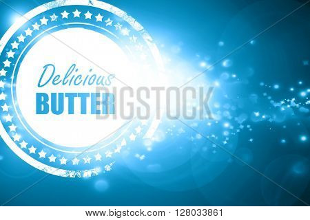 Blue stamp on a glittering background: Delicious butter sign