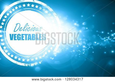 Blue stamp on a glittering background: Delicious vegetable sign