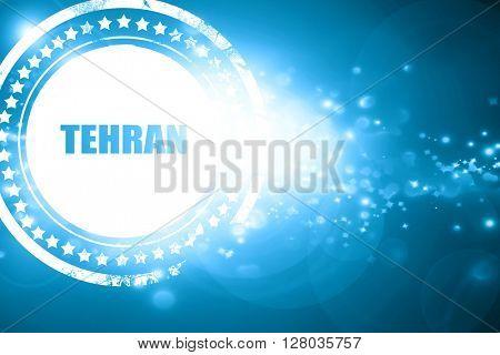 Blue stamp on a glittering background: tehran
