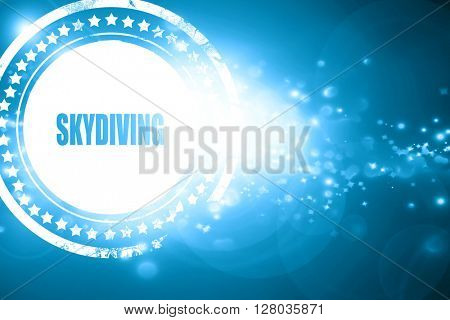 Blue stamp on a glittering background: skydiving sign background