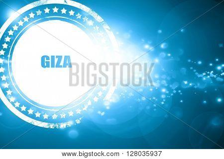 Blue stamp on a glittering background: giza