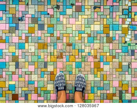 Colorful pavers and feet, brick road and feet