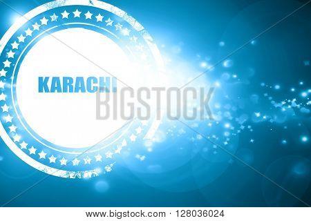 Blue stamp on a glittering background: karachi