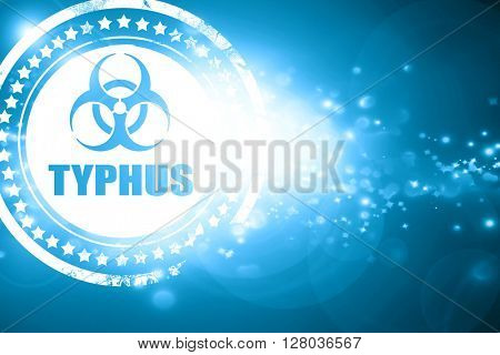 Blue stamp on a glittering background: Typhus concept background