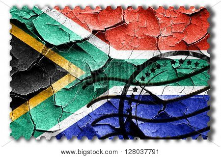 Grunge South africa flag with some cracks and vintage look