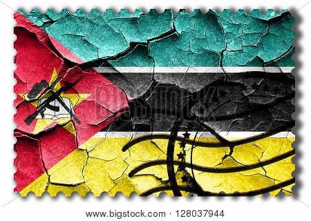 Grunge Mozambique flag with some cracks and vintage look
