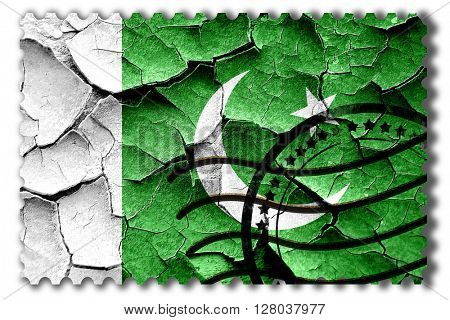 Grunge Pakistan flag with some cracks and vintage look