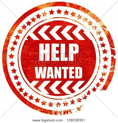 Help wanted sign, grunge red rubber stamp on a solid white backg