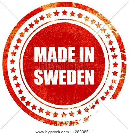 Made in sweden, grunge red rubber stamp on a solid white backgro